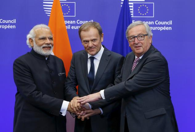 India's Prime Minister Narendra Modi (L) is welcomed by European Council President Donald Tusk (C) and European Commission President Jean-Claude Juncker at the start of a EU-India Summit in Brussels, Belgium, March 30, 2016.   REUTERS/Yves Herman