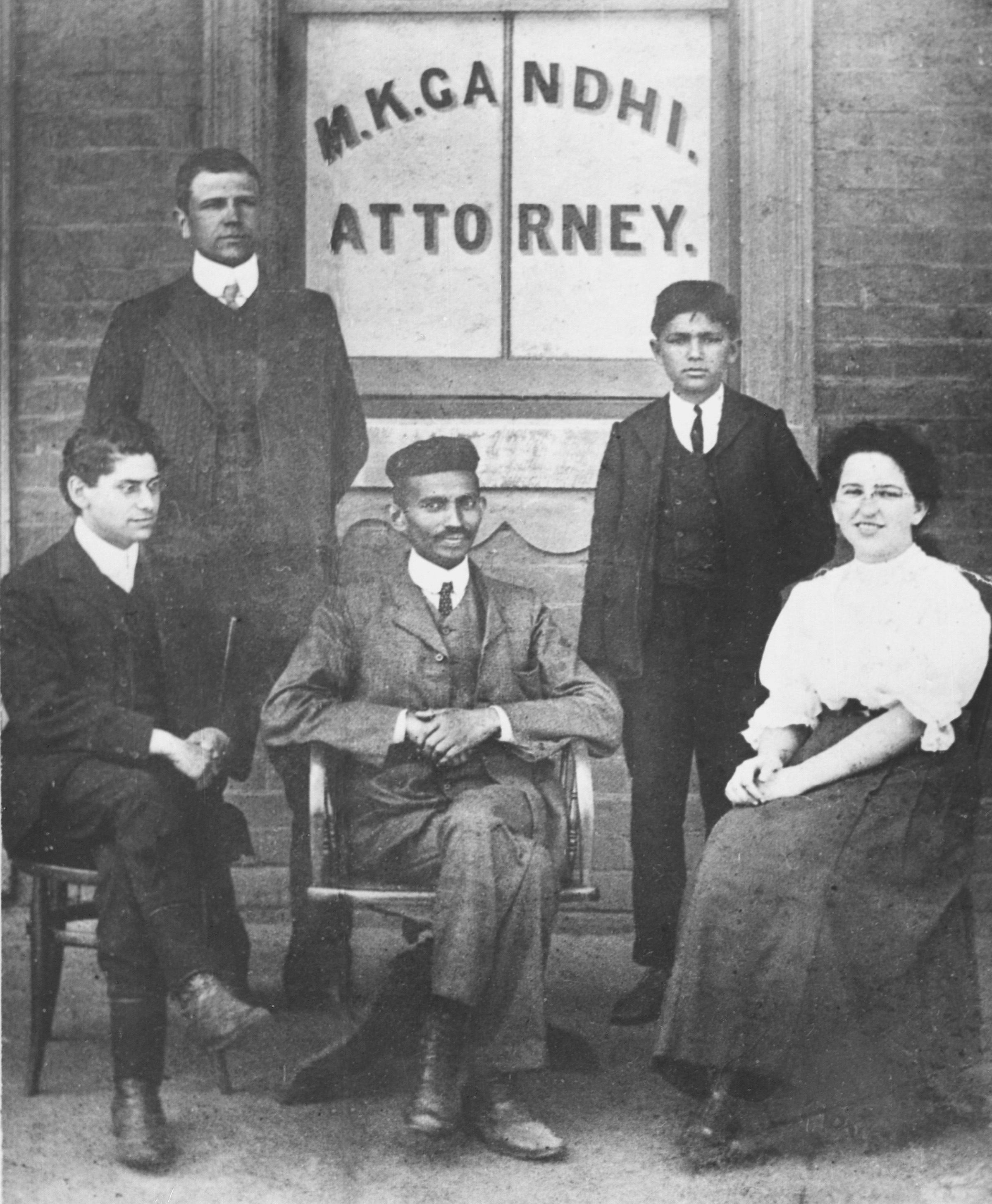 Gandhi sitting between his friend Henry Polak and secretary Sonja Schlesin